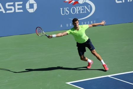 FLUSHING, NY - AUGUST 24  Professional tennis player Grigor Dimitrov from Bulgaria practices for US Open 2013 at Billie Jean King National Tennis Center on August 24, 2013 in Flushing, NY