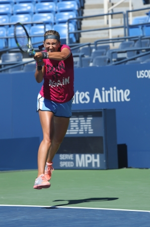 racket stadium: FLUSHING, NY - AUGUST 24  Two times  Grand Slam champion Victoria Azarenka practices for US Open 2013 at Arthur Ashe Stadium at Billie Jean King National Tennis Center on August 24, 2013 in Flushing, NY