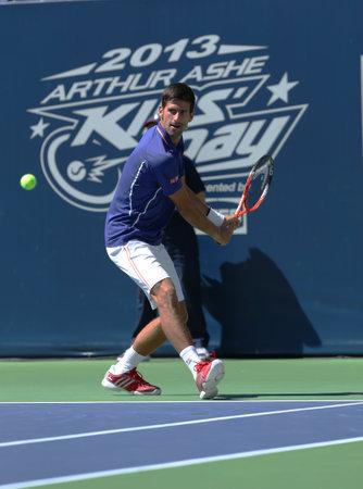 FLUSHING, NY - AUGUST 24  Seven times Grand Slam champion Novak Djokovic  participates at Arthur Ashe Kids day at Billie Jean King National Tennis Center on August 24, 2013 in Flushing, NY Stock Photo - 21754316