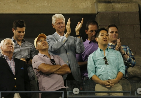 FLUSHING, NY - SEPTEMBER 8  President Clinton applauding to seventeen times Grand Slam champion and US Open 2013 champion Serena Williams after her final match win  against Victoria Azarenka at Billie Jean King National Tennis Center on September 8, 2013