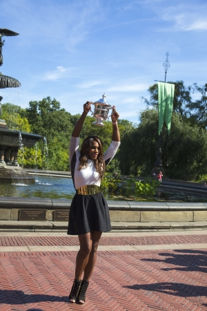 NEW YORK CITY - SEPTEMBER 9  US Open 2013 champion Serena Williams holding US Open trophy in Central Park on September 9, 2013