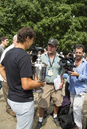 nadal: NEW YORK CITY - SEPTEMBER 10  US Open 2013 champion Rafael Nadal with US Open trophy surrounded by journalists during interview in Central Park on September 10, 2013 Editorial