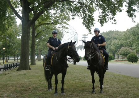 police unit: FLUSHING, NY- SEPTEMBER 2   NYPD police officers on horseback ready to protect public at Billie Jean King National Tennis Center during US Open 2013 on September 2, 2013 in Flushing, NY Editorial