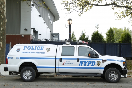 police unit: FLUSHING, NY- SEPTEMBER 1  NYPD emergency service unit providing security near National Tennis Center during US Open 2013 on September 1, 2013 in Flushing  The New York Police Department, established in 1845, is the largest police force in USA