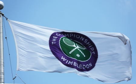 flushing: FLUSHING, NY - AUGUST 27  The Wimbledon championship flag at Billie Jean King National Tennis Center during  US Open 2013 on August 27, 2013 in Flushing, NY