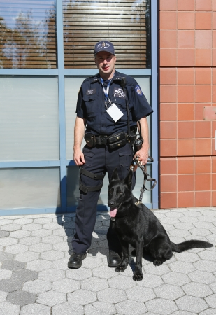 FLUSHING, NY- SEPTEMBER 8  NYPD transit bureau K-9 police officer and German Shepherd  K-9 Taylor providing security at National Tennis Center during US Open 2013 on September 8, 2013 in Flushing