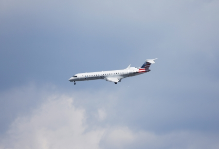 NEW YORK - SEPTEMBER 8  American Eagle Bombardier CL-600 plane in New York sky before landing in La Guardia Airport on September 8, 2013  American Eagle is the world s largest regional airline system