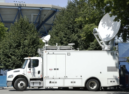 eyewitness: FLUSHING, NY -SEPTEMBER 7  CNN truck in the front of National Tennis Center on September 7, 2013 CNN was the first channel to provide 24-hour television news coverage