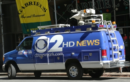 eyewitness: NEW YORK - AUGUST 15  WCBS Channel 2 van in midtown Manhattan on August 15, 2013  WCBS is a television station located in New York City and is the flagship station of the television network