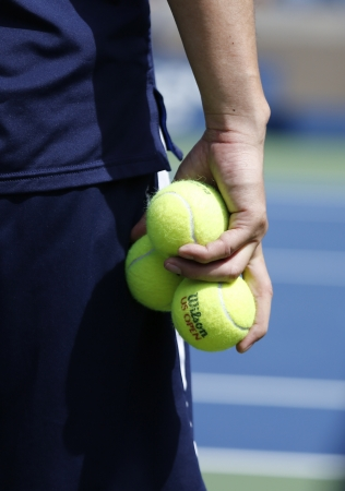 billie: FLUSHING, NY - SEPTEMBER 5  Ball boy holding Wilson tennis balls at the Billie Jean King National Tennis Center on September 5, 2013 in Flushing  Wilson is the Official Ball of the US Open since 1979