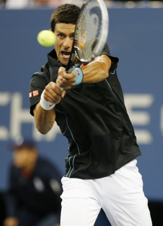 mikhail: FLUSHING, NY - SEPTEMBER 5    Professional tennis player Novak Djokovic during  quarterfinal match at US Open 2013 against Mikhail Youzhny  at Billie Jean King National Tennis Center on September 5, 2013 in Flushing, NY