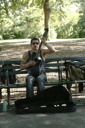 NEW YORK - SEPTEMBER 9  Unidentified guitar player performing in Central Park on September 9, 2013 Central Park is designated a National Historic Landmark in 1962 was officially opened in 1857