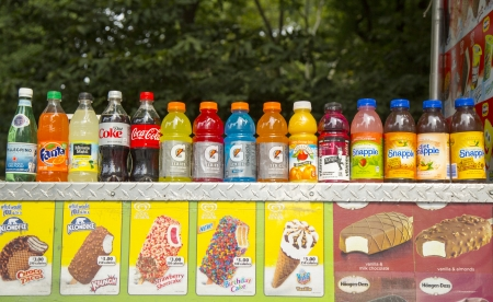 NEW YORK - SEPTEMBER 10  Soft beverages and ice cream at vendors cart in Central Park on September 10, 2013  Central Park is designated a National Historic Landmark in 1962 was officially opened in 1857