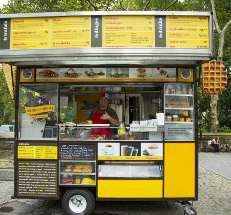NEW YORK - SEPTEMBER 10  Wafels and Dinges cart in Central Park on September 10, 2013  Central Park is designated a National Historic Landmark in 1962 was officially opened in 1857