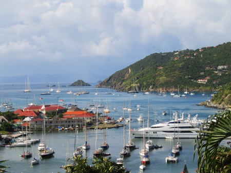 ST BARTS, FRENCH WEST INDIES - JANUARY 13 Aerial view at Gustavia Harbor with mega yachts on January 13, 2004 at St Barts  The island is popular tourist destination during the winter holiday season
