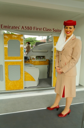 flushing: FLUSHING, NY - AUGUST 26  Emirates Airline flight attendant at the Emirates Airline booth at the Billie Jean King National Tennis Center during US Open 2013 on August 26, 2013 in Flushing, NY