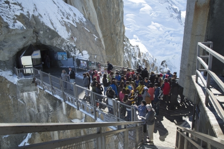 CHAMONIX, FRANCE - OCTOBER 9  Tourists arrived by cable car at the central footbridge at the Aiguille du Midi on October 9, 2013  It is a mountain 3 842 m high in Mont Blanc massif in the French Alps