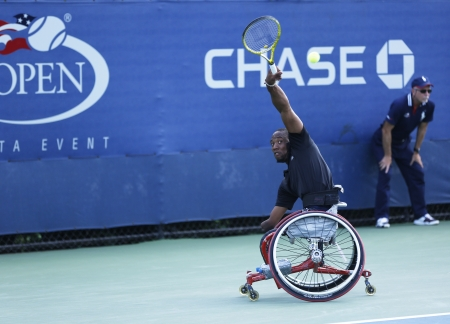 flushing: FLUSHING, NY - SEPTEMBER 8 Tennis player Lucas Sithole from South Africa during US Open 2013 wheelchair quad singles match at Billie Jean King National Tennis Center on September 8, 2013 in Flushing