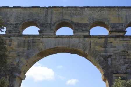 1st century: Arch of the Pont du Gard, ancient Roman aqueduct bridge build in the 1st century AD in southern France3  It is one of France s most popular attractions Stock Photo