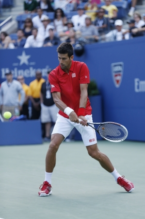 FLUSHING, NY - SEPTEMBER 3  Professional tennis player Novak Djokovic during  fourth round match at US Open 2013 against Marcel Granollers  at Billie Jean King National Tennis Center on September 3, 2013 in Flushing, NY Stock Photo - 23354771
