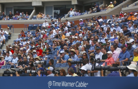 flushing: FLUSHING, NY - SEPTEMBER 3  Professional photographers and spectators during US Open 2013 at the Arthur Ashe Stadium at Billie Jean King National Tennis Center on September 3, 2013 in Flushing