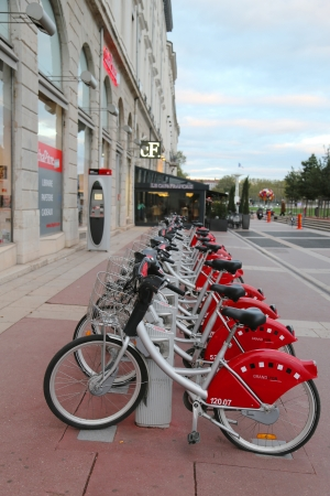 v cycle: LYON, FRANCE - OCTOBER 10  Velo v bicycle sharing station in Lyon on October 10, 2013  Lyon is known for its historical and architectural landmarks and is a UNESCO World Heritage Site