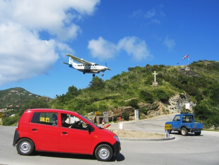collectivity: ST  BARTS, FRENCH WEST INDIES - JANUARY 14  Risky plane landing at St Barts airport on January 14, 2004  At 2133 ft its runway is one of the shortest in the world  Editorial