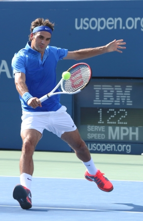 flushing: FLUSHING, NY - AUGUST 27  Seventeen times Grand Slam champion Roger Federer during his first round match at US Open 2013 against Grega Zemlja at Billie Jean King National Tennis Center on August 27, 2013 in Flushing, NY
