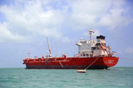 petrolium: BELIZE - JUNE 9  Ocean Mariner tanker near Belize City on June 9, 2013  Ocean Mariner is an oil and chemical tanker with port of registry Valetta, Malta