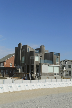 fema: FAR ROCKAWAY, NY - OCTOBER 22  Damaged beach house in devastated area one year after Hurricane Sandy on October 22, 2013 in Far Rockaway, NY  Notice protective barrier build to prevent flooding
