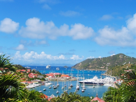 indies: ST BARTS, FRENCH WEST INDIES - JANUARY 19 Aerial view at Gustavia Harbor with mega yachts on January 19, 2005 at St Barts  The island is popular tourist destination during the winter holiday season