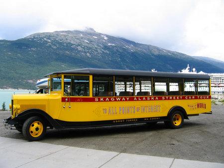 SKAGWAY, ALASKA - JULY 28  Skagway Alaska Street Car Tour bus at Skagway harbor on Junly 28, 2004  The port of Skagway is a popular stop for cruise ships Editöryel