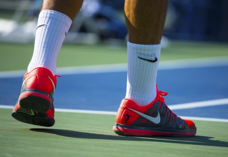 NEW YORK - AUGUST 27 Seventeen times Grand Slam champion Roger Federer wears custom Nike tennis shoes during match at US Open 2013 at Billie Jean King National Tennis Center on August 27, 2013 in NY Editorial