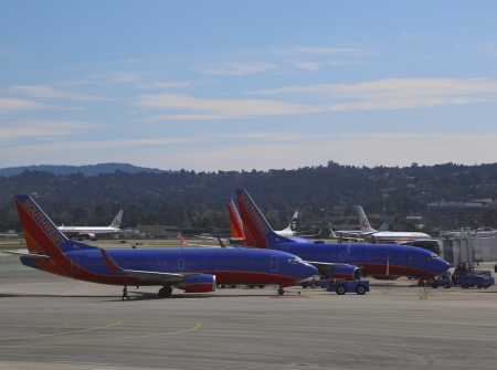 SAN FRANCISCO, CA - MARCH 29 Southwest Airlines planes ready to take off on March 29, 2013 at San Francisco airport  Southwest Airlines is a major US airline and the world s largest low-cost carrier