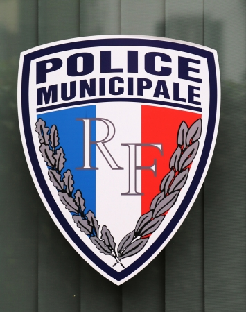 lyon: LYON, FRANCE - OCTOBER 9  Municipal police sign in Lyon on October 9, 2013  The Municipal Police are the local police of towns and cities in France under the direct authority of the Mayor