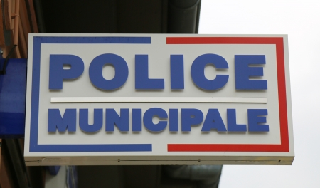 LYON, FRANCE - OCTOBER 9  Municipal police sign in Lyon on October 9, 2013  The Municipal Police are the local police of towns and cities in France under the direct authority of the Mayor