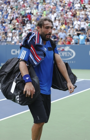 louis armstrong: NEW YORK - SEPTEMBER 1 Professional tennis player Marcos Baghdatis from Cyprus leaving Louis Armstrong stadium after third round match loss  at US Open 2013 against Stanislas Wawrinka on September 1, 2013 in New York Editorial