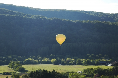 Hot air balloon flying over Dordogne in southwestern France