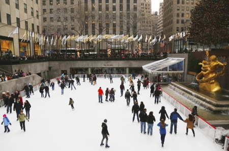 iceskating: NEW YORK - DECEMBER 19  Lower Plaza of Rockefeller Center with ice-skating rink  and Christmas tree in Midtown Manhattan on December 19, 2013  Ice-skating began since Christmas Day in 1936  Editorial