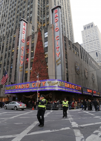 gridlock: NEW YORK - DECEMBER 19  NYPD officers regulate traffic during gridlock near New York City landmark Radio City Music Hall in Rockefeller Center  on December 19, 2013 Editorial