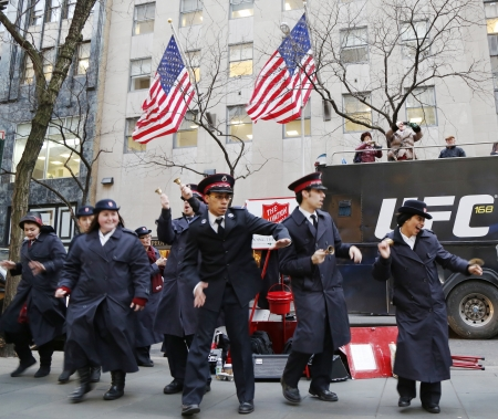 NEW YORK - DECEMBER 19  Salvation Army soldiers perform for collections on December 19, 2013 in midtown Manhattan  This Christian organization is known for its charity work, operating in 126 countries