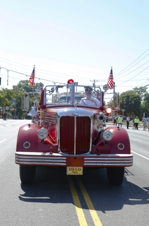 mack: HUNTINGTON, NY - SEPTEMBER 7  1950 Mack fire truck from Huntington Manor Fire Department at parade in Huntington on September 7, 2013  Huntington Manor Fire Department organized in 1903 Editorial