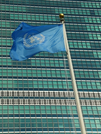 headquarter: United Nations Flag in the front of UN Headquarter in New York  Editorial