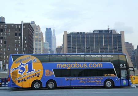 NEW YORK - DECEMBER 2  Megabus in midtown Manhattan on December 2, 2013  Megabus com provides a low cost inter city travel with prices starting from as little as  1