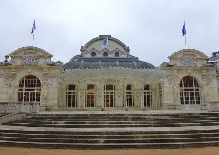 napoleon iii: VICHY, FRANCE -OCTOBER 8  The casino now the convention center in Vichy on October 8, 2013 It is famous for its Napoleon III facade and airy Art Nouveau glass canopy added in 1900  Editorial
