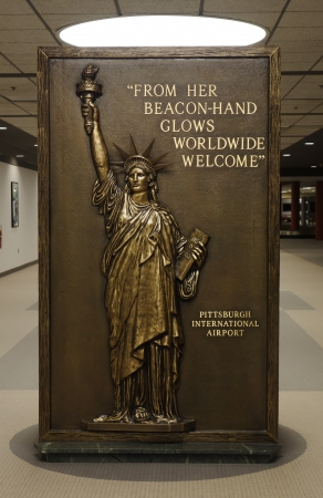airborne vehicle: PITTSBURGH, PENNSYLVANIA -JANUARY 4 Sign with Statue of Liberty in Pittsburgh International Airport on January 4, 2014  Pittsburgh International Airport is a civil mili tary airport in Pennsylvania  Editorial
