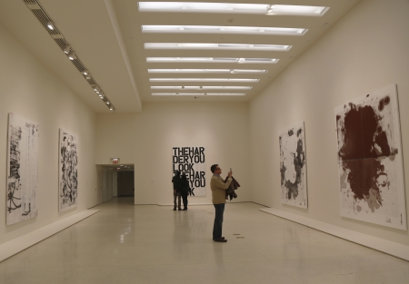 NEW YORK - JANUARY 12  Visitors in Solomon R  Guggenheim Museum of modern and contemporary art in New York during Christopher Wool exhibition on January 12, 2014