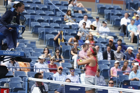an umpire: NEW YORK - SEPTEMBER 3 Two times Grand Slam champion Victoria Azarenka argues with chair umpire during quarterfinal match at US Open 2013 at Arthur Ashe Stadium on September 3, 2013 in New York
