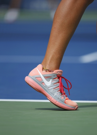 atp: NEW YORK - September 3  Two times Grand Slam champion Victoria Azarenka wears custom Nike tennis shoes during fourth round match at US Open 2013 at Arthur Ashe Stadium on September 3, 2013 in NY  Editorial