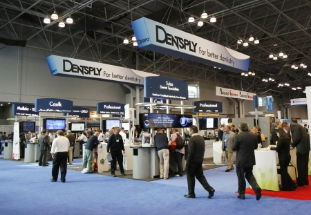 NEW YORK - DECEMBER 2 Dentsply booth at the Greater NY Dental Meeting in New York on December 2, 2013  Dentsply International is an American dental equipment maker and dental consumables producer
